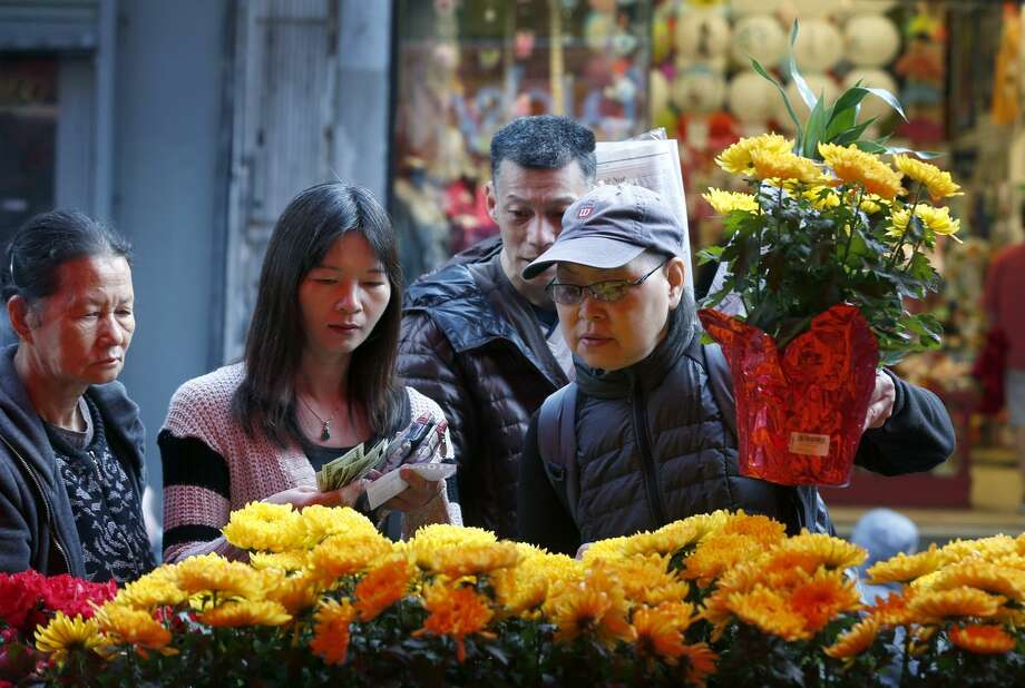 fairgoers select plants and bouquets at the chinese new year flower market fair the plants - What Is The Chinese New Year