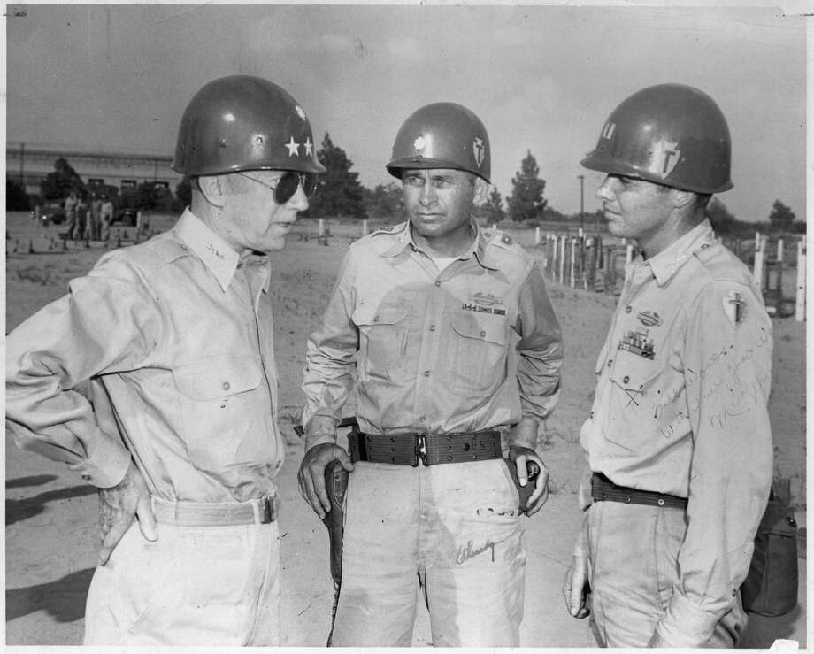 World War II hero Audie Murphy is show with two fellow guardsmen at a Texas National Guard summer encampment in the 1950s. Murphy served in the 36th Infantry division. Photo: Courtesy