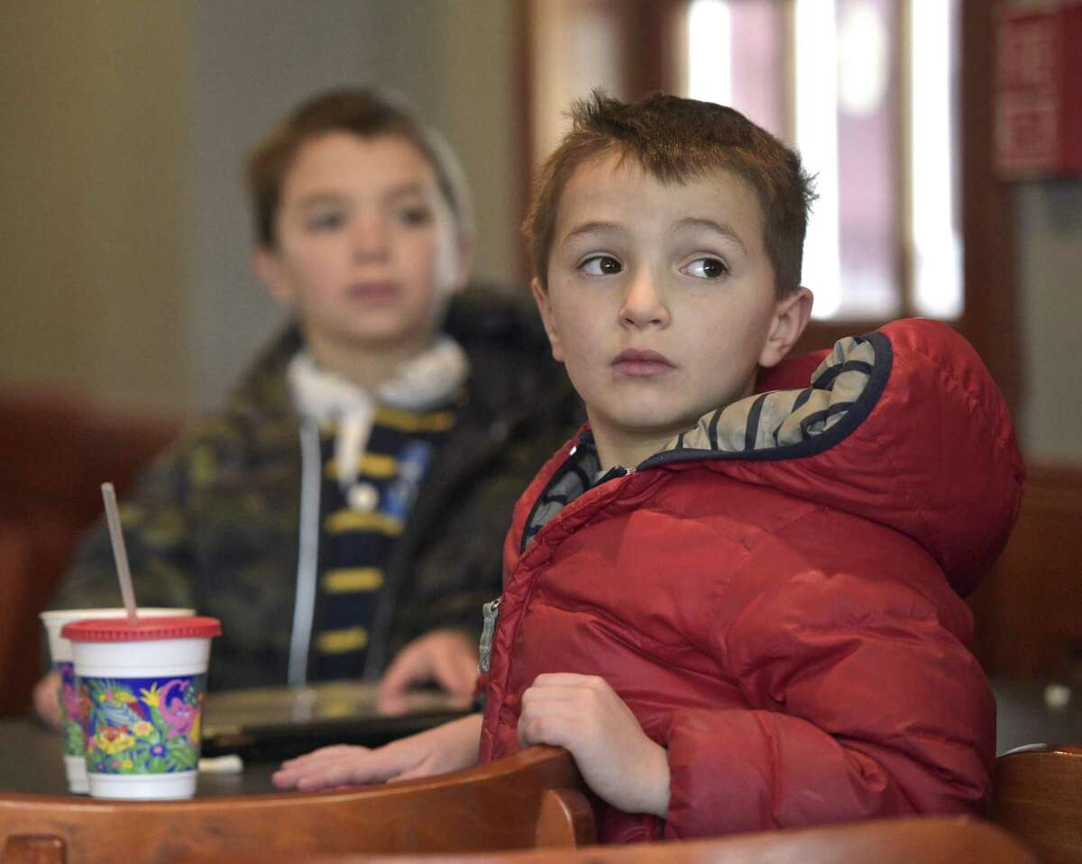 Twins Harris, right, and Carson Dressel, 6, of Ridgefield, watch Ridgefield Olympian Tucker West compete in the men's luge at the 2018 PyeongChang Olympic Games, South Korea, at the Tigers Den Sports Bar and Grill in Ridgefield on Saturday.