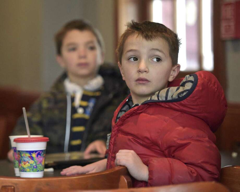 Twins Harris, right, and Carson Dressel, 6, of Ridgefield, watch Ridgefield Olympian Tucker West compete in the men's luge at the 2018 PyeongChang Olympic Games, South Korea, at the Tigers Den Sports Bar and Grill in Ridgefield on Saturday. Photo: H John Voorhees III / Hearst Connecticut Media / The News-Times