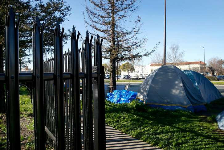A spiked steel fence is erected at the site of a former homeless encampment next to BART tracks at Martin Luther King Jr. Boulevard and 63rd Street in Berkeley, Calif. on Saturday, Feb. 10, 2018. BART installed the fence to prevent the campers from returning but the prison-like fence has angered a Berkeley city council member and many residents.