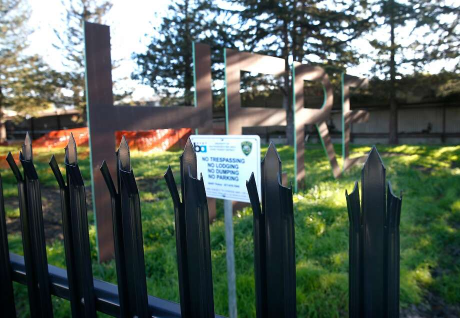A warning sign is posted behind a spiked steel fence erected at the site of a former homeless encampment next to BART tracks at Martin Luther King Jr. Boulevard and 63rd Street in Berkeley. Photo: Paul Chinn, The Chronicle