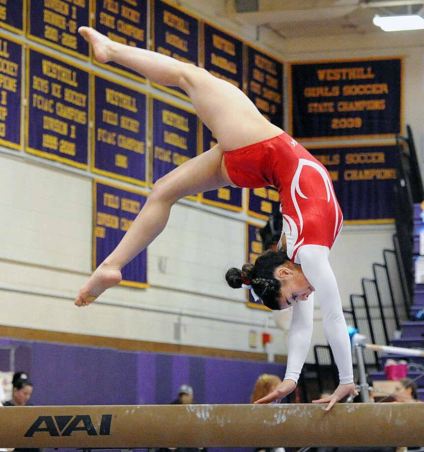 Greenwich's Adnerys De Jesus competes on the balance beam during the FCIAC Championship at Westhill High School in Stamford on Saturday. Photo: Bob Luckey Jr. / Hearst Connecticut Media / Greenwich Time