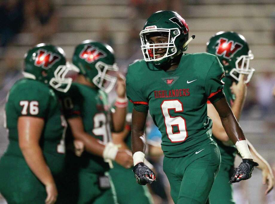The Woodlands wide receiver Kesean Carter (6) smiles after catching 20-yard touchdown pass from quarterback Quinn Binney during the third quarter of a non-district high school football game at Woodforest Bank Stadium, Friday, Sept. 22, 2017, in Shenandoah. Photo: Jason Fochtman, Staff Photographer / © 2017 Houston Chronicle