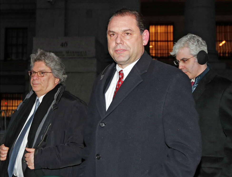 FILE - In this Feb. 1, 2018 file photo, Joseph Percoco, center, one of Gov, Andrew Cuomo's former executive deputy secretary, leaves U.S. District court with attorney Barry Bohrer, left, and others after appearing in his federal bribery trial in New York. Percoco has pleaded not guilty. His lawyers say his legal acts are being falsely portrayed as crimes by the government's star witness, Todd Howe. (AP Photo/Kathy Willens, File)