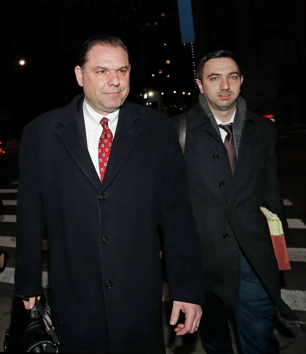 Joseph Percoco, left, Gov, Andrew Cuomo's former executive deputy secretary, leaves U.S. District Court with one of his attorneys after appearing in his federal bribery trial, Thursday, Feb. 1, 2018, in New York. Percoco has pleaded not guilty to charges that he pocketed over $300,000 in bribes to help three businessmen clear state government obstacles. (AP Photo/Kathy Willens)