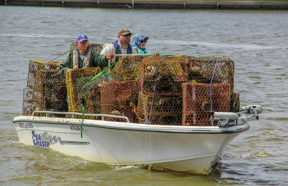 Volunteers have removed more than 32,000 derelict crab traps from Texas bays, saving hundreds of thousands of crabs and other marine life, during past annual clean-up efforts. Photo: Texas Parks And Wildlife Department