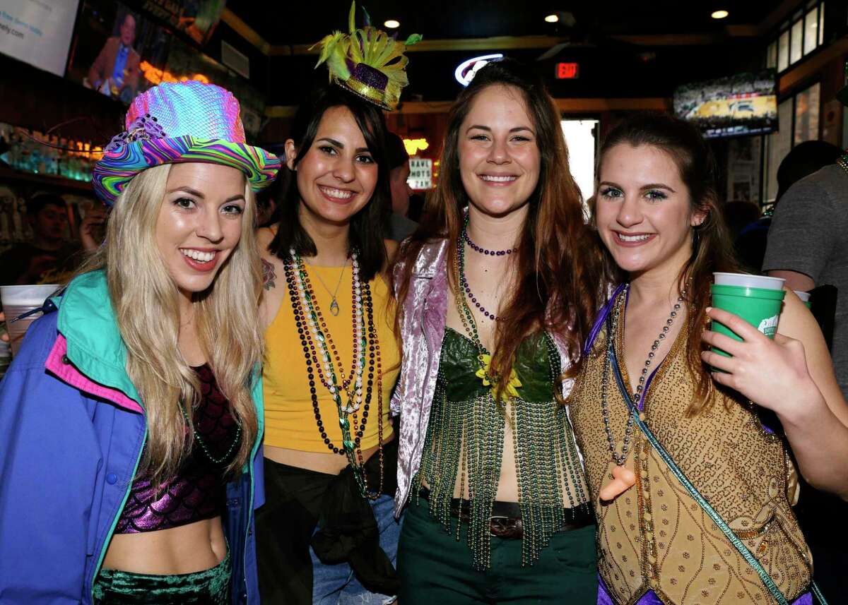 Attendees take part in the Mardi Gras Pub Crawl at various bars in downtown Houston, TX, Feb. 10, 2018. (Michael Wyke / For the Chronicle)
