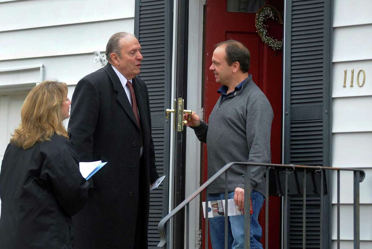 Republican state representative candidate Bill Cabral chats with resident Andrew Verow, right, and he and Stratford Mayor Laura Hoydick, left, go door to door in Stratford, Conn. on Saturday Nov. 10, 2018. Cabral is running for the seat being vacated by Mayor Hoydick. The special election is on Feb. 27th.