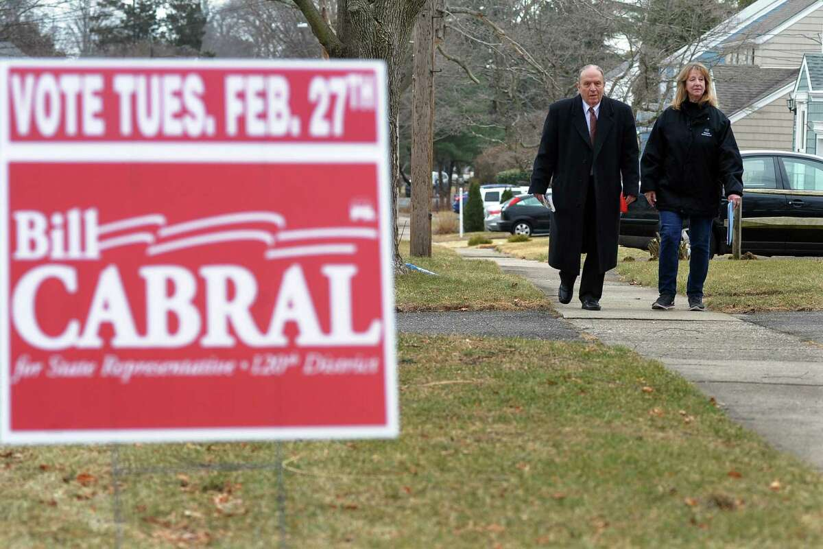 Republican state representative candidate Bill Cabral and Stratford Mayor Laura Hoydick, right, go door to door in Stratford, Conn. on Saturday Nov. 10, 2018. Cabral is running for the seat being vacated by Mayor Hoydick. The special election is on Feb. 27th.