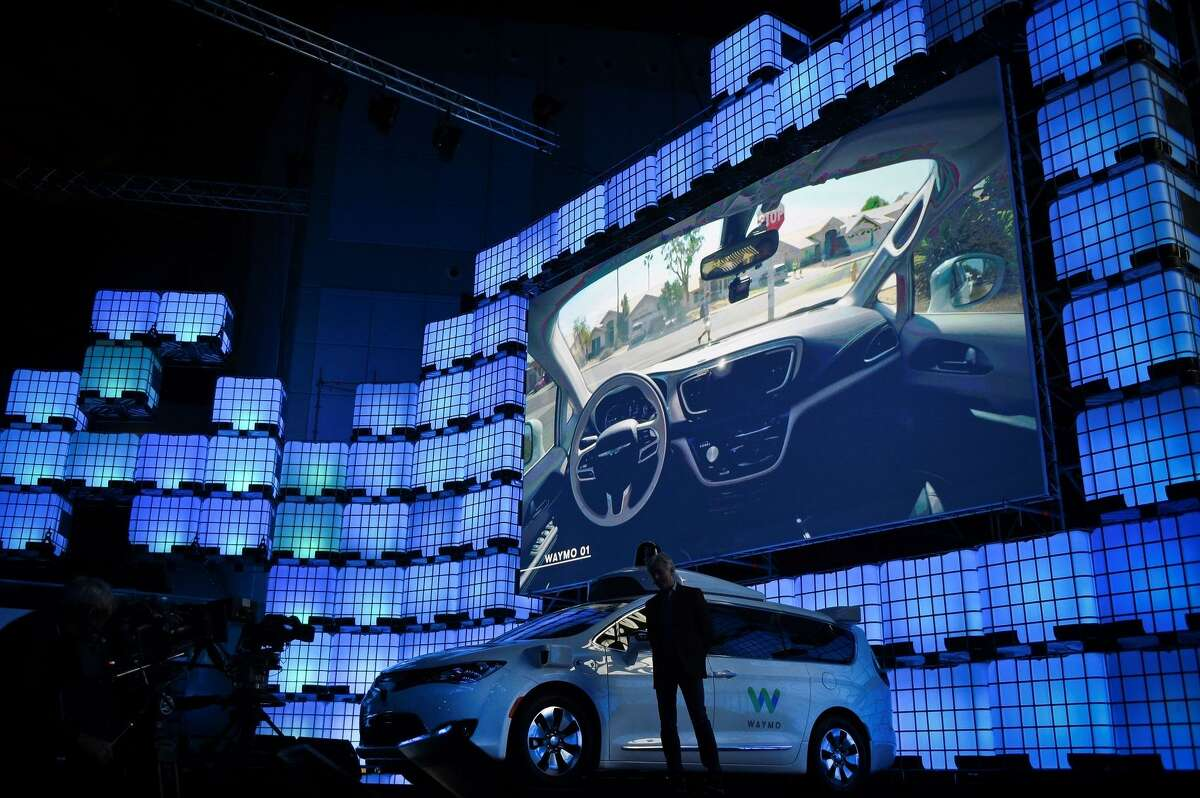 Waymo CEO John Krafcik delivers a speech about self-driving cars at the 2017 Web Summit in Lisbon, Portugal.