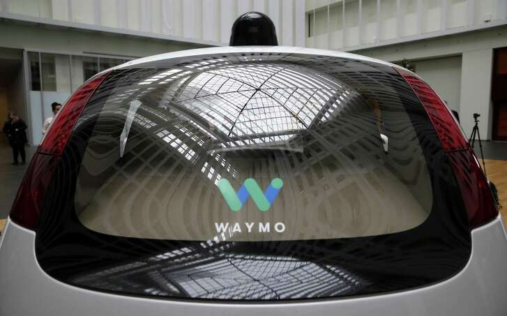 The Waymo self-driving car, seen from the rear, is unveiled at Google's offices in 2016.