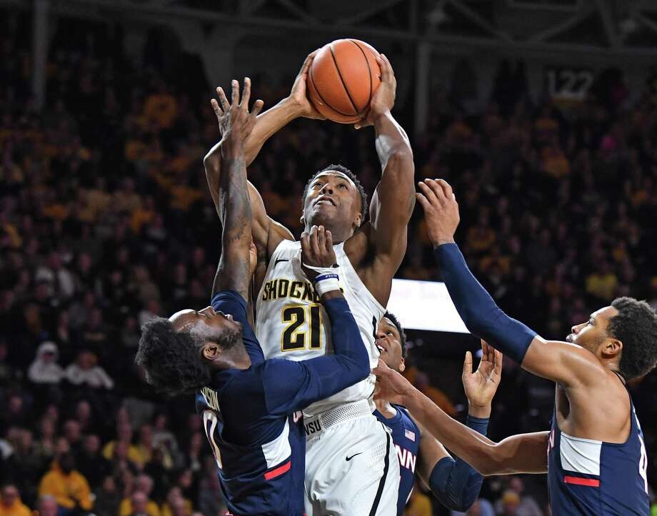 Darral Willis Jr. of Wichita State drives in for a basket against UConn's Antwoine Anderson on Saturday. Photo: Peter Aiken / Getty Images / 2018 Getty Images