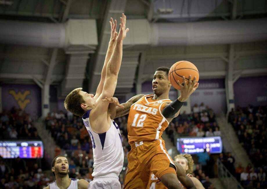 Texas' Kerwin Roach, right, tries to fend off TCU's Vladimir Brodziansky, who did his best work on the offensive end for the Horned Frogs with a game-high 25 points Saturday. Photo: Joyce Marshall, MBR / Fort Worth Star-Telegram