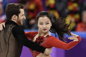 South Korea's Yura Min and South Korea's Alexander Gamelin compete in the figure skating team event ice dance short dance during the Pyeongchang 2018 Winter Olympic Games at the Gangneung Ice Arena in Gangneung on February 11, 2018. / AFP PHOTO / ARIS MESSINIS        (Photo credit should read ARIS MESSINIS/AFP/Getty Images)