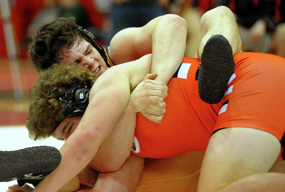 Jonathan Law's Kevin Brocksom works to turn over Shelton's Ray Weiner during SCC Wrestling Championship action in Fairfield, Conn. on Saturday Feb. 10, 2018. Photo: Christian Abraham / Hearst Connecticut Media / Connecticut Post