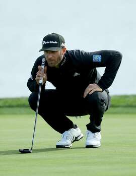 PEBBLE BEACH, CA - FEBRUARY 10:  Dustin Johnson lines up a putt on the 18th green during Round Three of the AT&T Pebble Beach Pro-Am at Spyglass Hill Golf Course on February 10, 2018 in Pebble Beach, California. (Photo by Warren Little/Getty Images)
