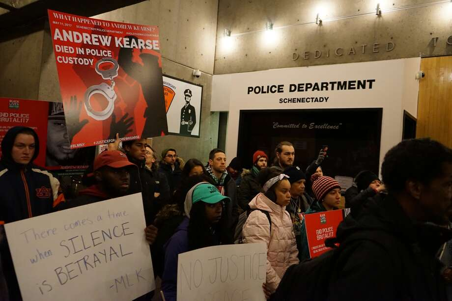 Protesters stand inside Schenectady Police Headquarters on Feb. 10, 2018 to demand an explanation of the death of Andrew Kearse. Kearse, a Bronx man, died while in police custody last May. (Massarah Mikati/Times Union)