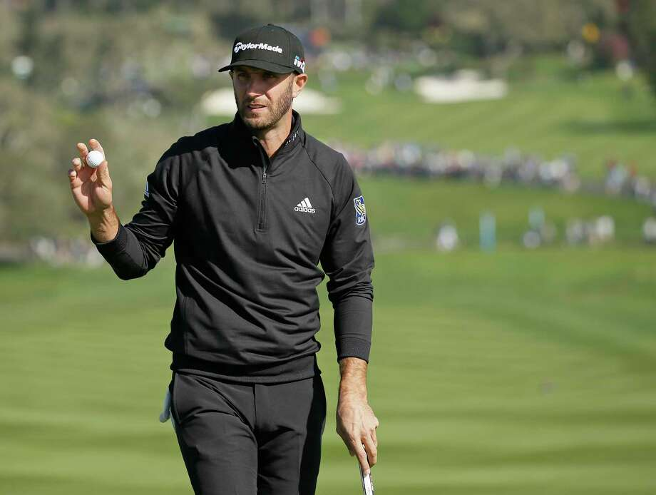 Dustin Johnson holds up his ball after making a birdie on the sixth green of the Pebble Beach Golf Links during the third round of the AT&T Pebble Beach National Pro-Am golf tournament Saturday, Feb. 10, 2018, in Pebble Beach, Calif. (AP Photo/Eric Risberg) Photo: Eric Risberg / Copyright 2018 The Associated Press. All rights reserved.