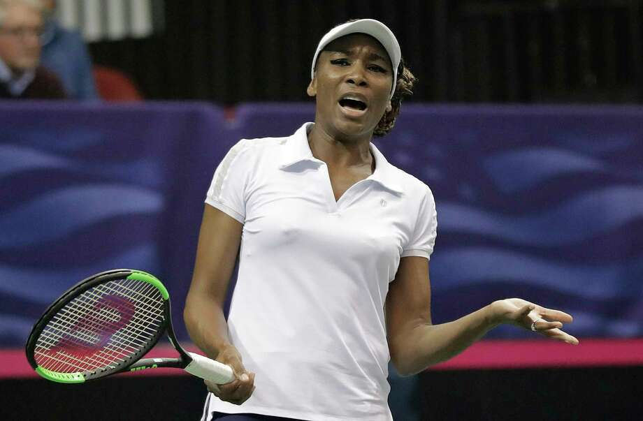 CORRECTS SPELLING OF FIRST NAME TO ARANTXA, NOT ARNATXA - USA's Venus Williams reacts to a shot against Netherlands' Arantxa Rus during a match in the first round of Fed Cup tennis competition in Asheville, N.C., Saturday, Feb. 10, 2018. (AP Photo/Chuck Burton) Photo: Chuck Burton / Copyright 2018 The Associated Press. All rights reserved.
