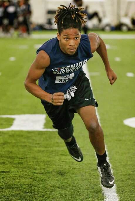 Willowridge senior D.J. Johnson, one of 300-plus attendees hoping to land a college scholarship offer, runs drills Saturday during the Texans Senior Showcase for football players at the NRG bubble. Photo: Steve Gonzales, Houston Chronicle / © 2018 Houston Chronicle