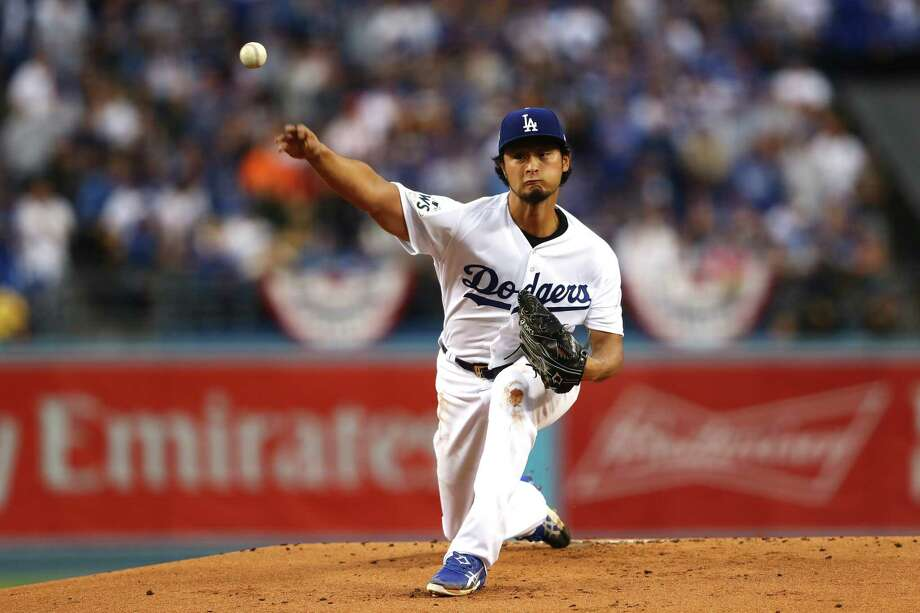 LOS ANGELES, CA - NOVEMBER 01:  Yu Darvish #21 of the Los Angeles Dodgers pitches in the first inning against the Houston Astros in game seven of the 2017 World Series at Dodger Stadium on November 1, 2017 in Los Angeles, California.  (Photo by Tim Bradbury/Getty Images) ORG XMIT: 775063336 Photo: Tim Bradbury / 2017 Getty Images