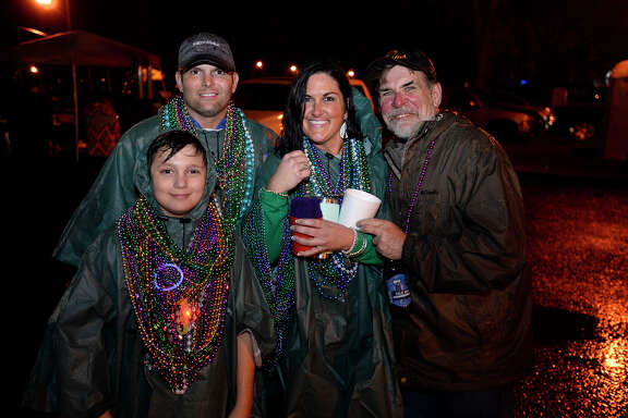 Revelers during the Majestic Krewe of Aurora parade at Mardis Gras Southeast Texas in Port Arthur on Saturday evening.  Photo taken Saturday 2/10/18 Ryan Pelham/The Enterprise