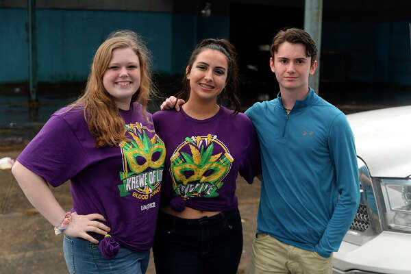 Chaylee Cleckley, Kourtney Hart and Thomas Cooper before the Majestic Krewe of Aurora parade at Mardis Gras Southeast Texas in Port Arthur on Saturday evening.  Photo taken Saturday 2/10/18 Ryan Pelham/The Enterprise