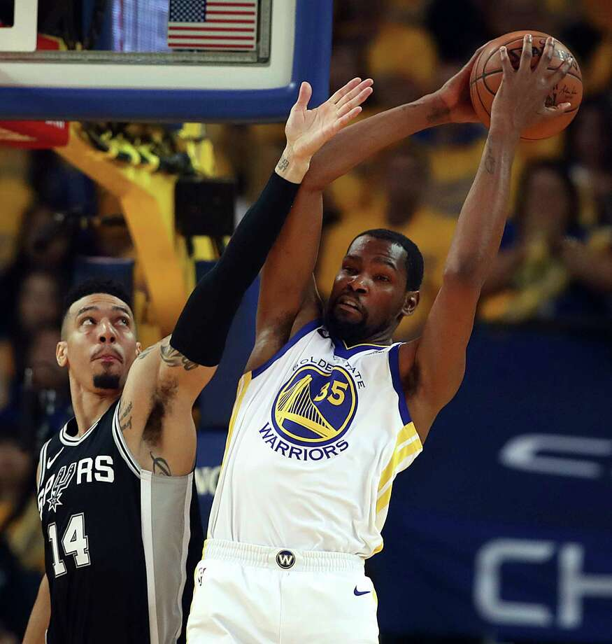 Golden State Warriors' Kevin Durant, right, rebounds over San Antonio Spurs' Danny Green during the first quarter in Game 5 of a first-round NBA basketball playoff series Tuesday, April 24, 2018, in Oakland, Calif. (AP Photo/Ben Margot) Photo: Ben Margot, Associated Press / Copyright 2018 The Associated Press. All rights reserved.