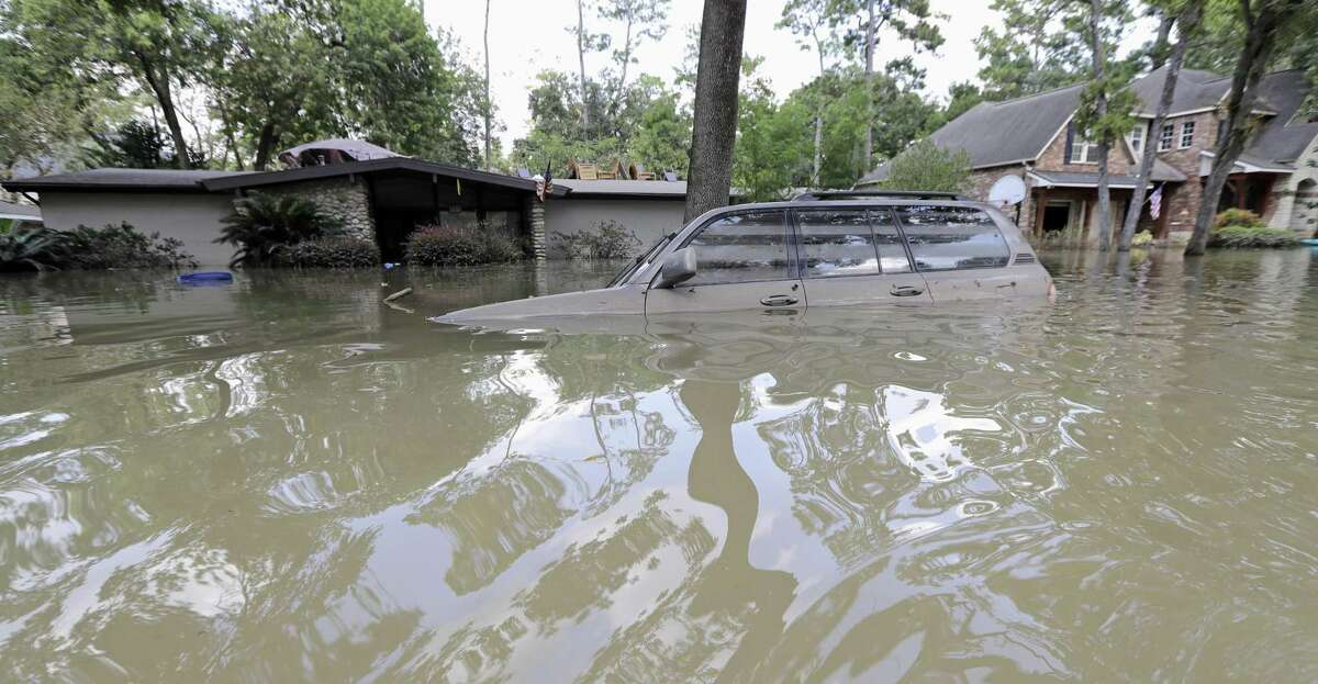 In this Sept. 4 photo, a car is submerged in floodwaters in the aftermath of Hurricane Harvey near the Addicks and Barker Reservoirs in Houston. The budget bill includes an $89.3 billion disaster aid package for Texas, Florida, Puerto Rico and other areas hit by a series of floods, fires and hurricanes last year.