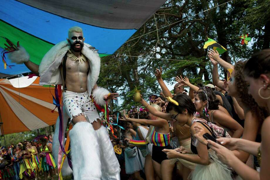 A reveler in a werewolf costume performs on stilts during the Terreirada Cearense street carnival party in Rio de Janeiro, Brazil, Saturday, Feb. 10, 2018. Much of the appeal of Rio street parties is the variety of themes and that people can dress up in costumes or not. (AP Photo/Silvia Izquierdo) Photo: Silvia Izquierdo / Copyright 2018 The Associated Press. All rights reserved.