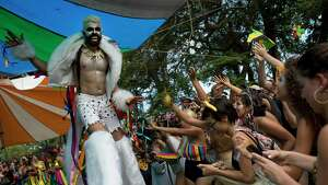 A reveler in a werewolf costume performs on stilts during the Terreirada Cearense street carnival party in Rio de Janeiro, Brazil, Saturday, Feb. 10, 2018. Much of the appeal of Rio street parties is the variety of themes and that people can dress up in costumes or not. (AP Photo/Silvia Izquierdo)