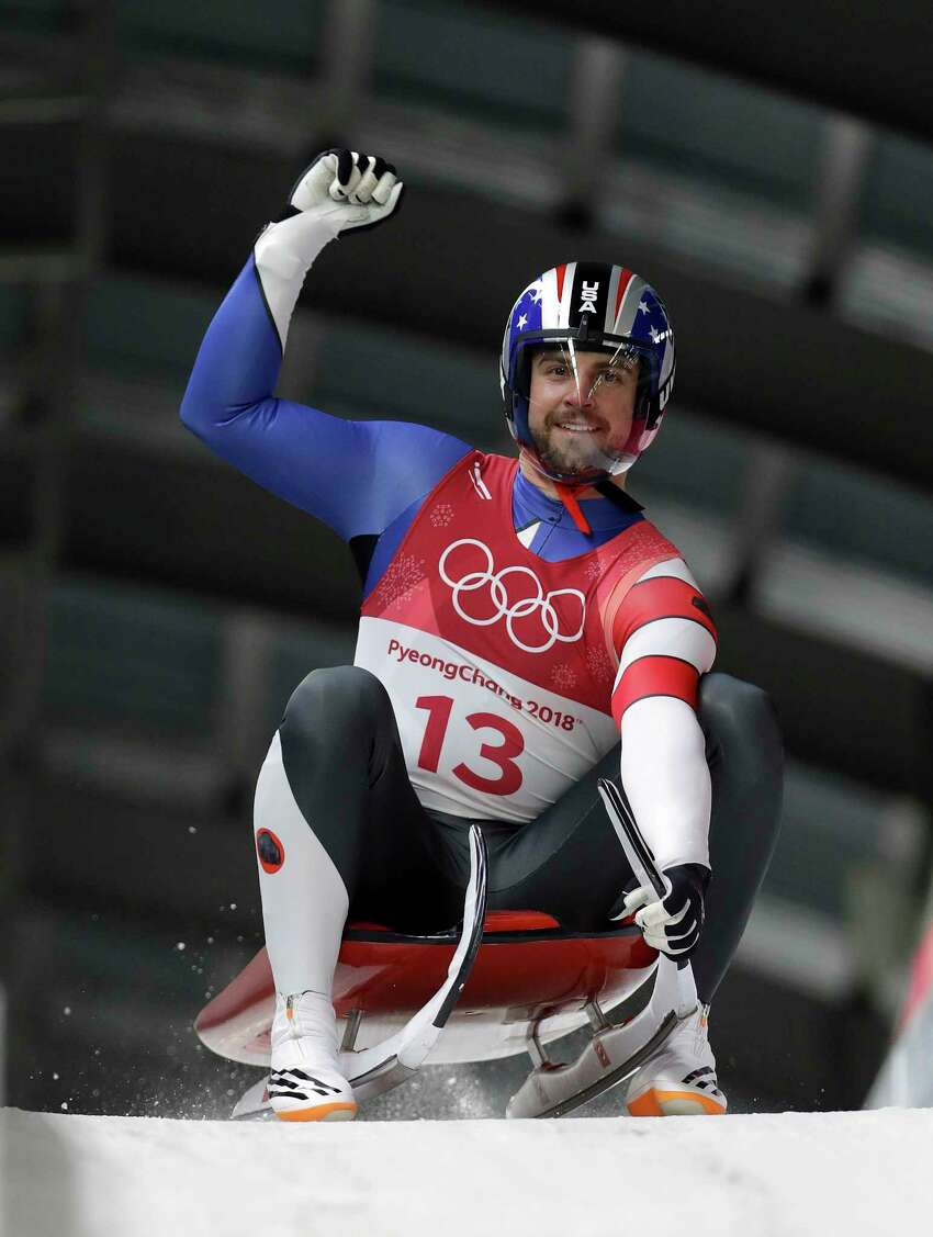 Chris Mazdzer of United States brakes in the finish area after his second run in the men's luge at the 2018 Winter Olympics in Pyeongchang, South Korea, Saturday, Feb. 10, 2018. (AP Photo/Michael Sohn)