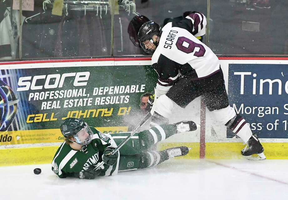 Union's forward Ryan Scarfo (9) moves the puck past Dartmouth's defenseman Joey Matthews (3) during the first period of an NCAA college hockey game Saturday, Feb. 10, 2018, in Schenectady, N.Y., (Hans Pennink / Special to the Times Union) Photo: Hans Pennink / Hans Pennink