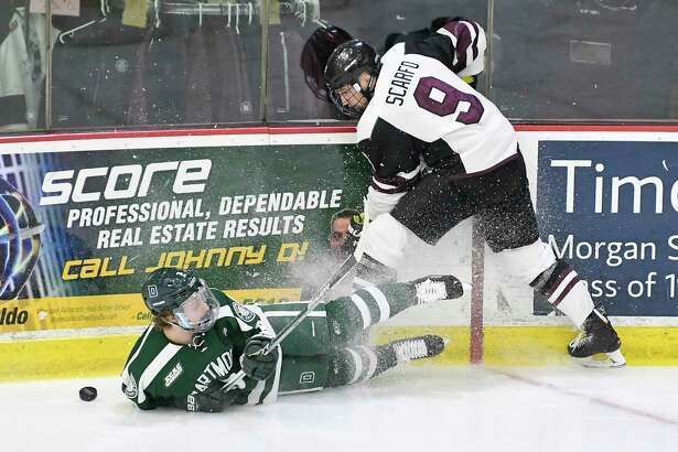 Union's forward Ryan Scarfo (9) moves the puck past Dartmouth's defenseman Joey Matthews (3) during the first period of an NCAA college hockey game Saturday, Feb. 10, 2018, in Schenectady, N.Y., (Hans Pennink / Special to the Times Union)