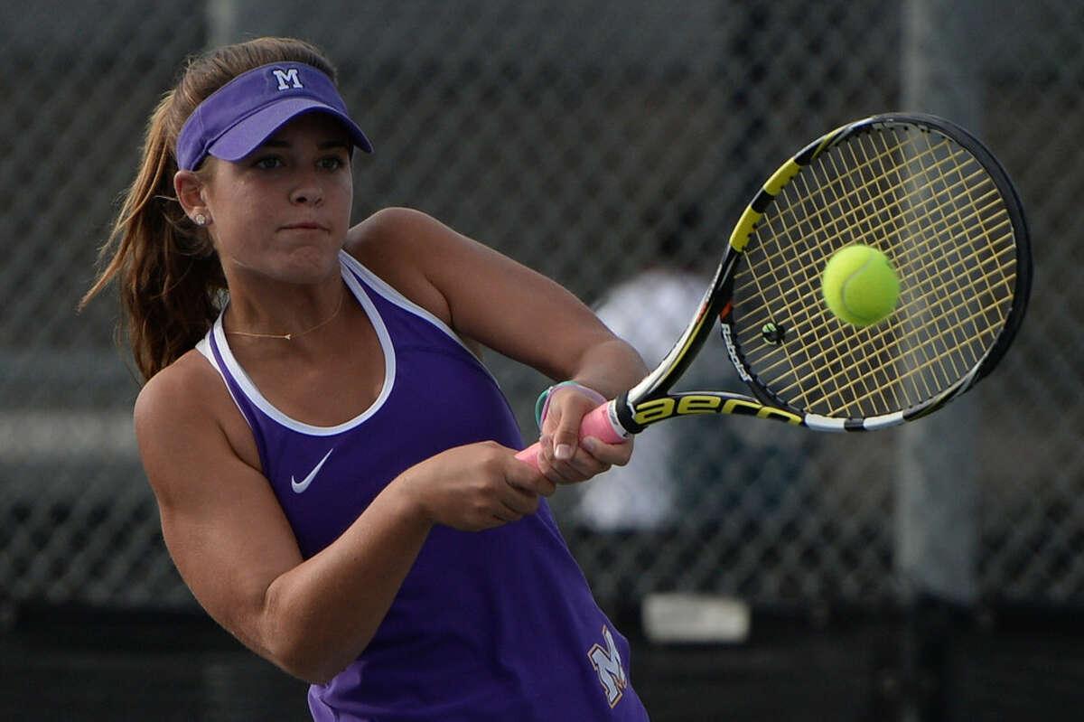 Midland High's Allison Stewart competes in a tennis match against Lee Oct. 3, 2017, at Bush Tennis Center. James Durbin/Reporter-Telegram