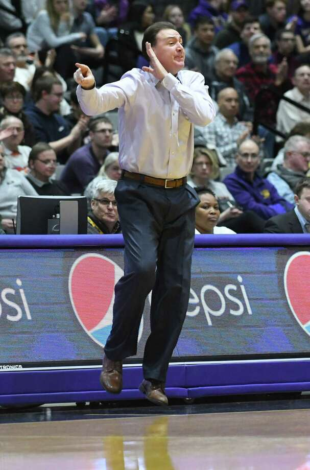 University at Albany head coach Will Brown jumps as he yells to his players during a basketball game against Vermont at SEFCU Arena on Thursday, Feb. 8, 2018 in Albany, N.Y. (Lori Van Buren/Times Union) Photo: Lori Van Buren / 0042387A