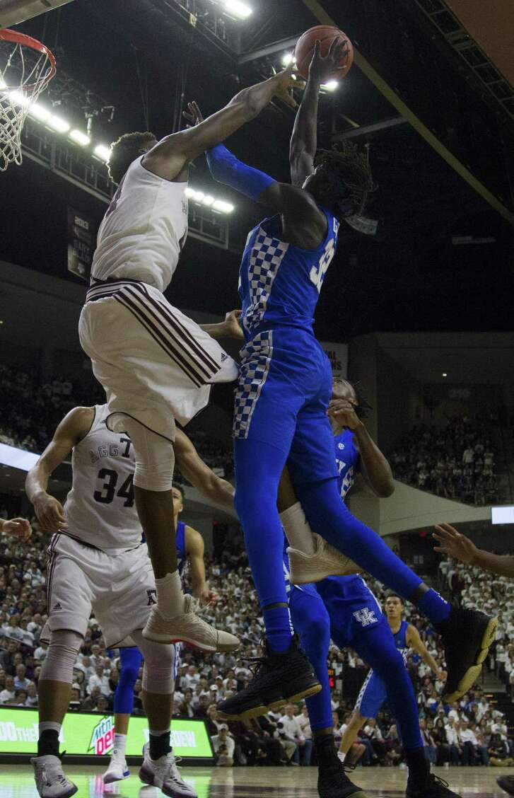 A&M forward Robert Williams (left) contests a shot by Kentucky forward Wenyen Gabriel during the second half.