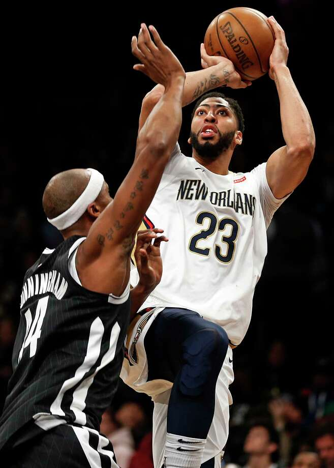 New Orleans Pelicans' Anthony Davis (23) shoots over Brooklyn Nets' Dante Cunningham during the first half of an NBA basketball game, Saturday, Feb. 10, 2018, in New York. (AP Photo/Adam Hunger) Photo: Adam Hunger / FR110666 AP