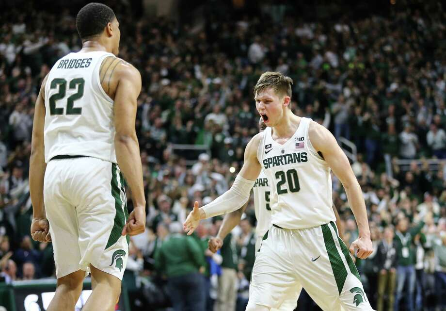 EAST LANSING, MI - FEBRUARY 10: Miles Bridges #22 of the Michigan State Spartans celebrates with Matt McQuaid #20 of the Michigan State Spartans late in the second half during a game against the Purdue Boilermakers at Breslin Center on February 10, 2018 in East Lansing, Michigan. (Photo by Rey Del Rio/Getty Images) Photo: Rey Del Rio / 2018 Getty Images
