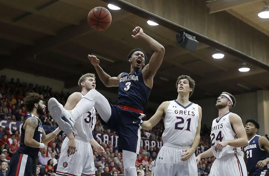 Gonzaga forward Johnathan Williams (3) celebrates after dunking, as Saint Mary's Jock Landale (34), Evan Fitzner (21) and Calvin Hermanson (24) watch during the first half of an NCAA college basketball game Saturday, Feb. 10, 2018, in Moraga, Calif. (AP Photo/Marcio Jose Sanchez) Photo: Marcio Jose Sanchez, Associated Press