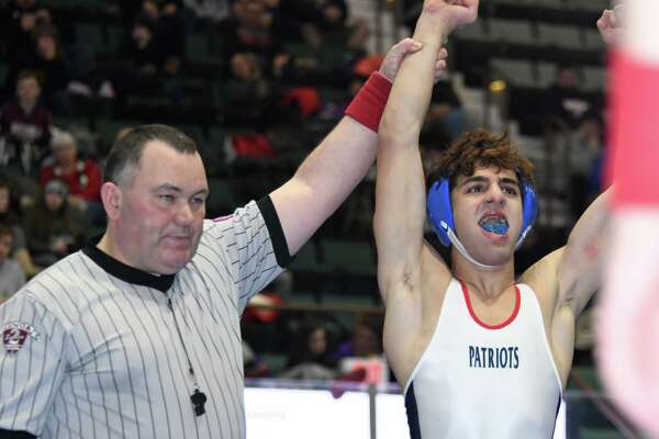 Schenectady's Billal Zamani cheers as a referee holds his hand up for winning his final match agains Shen's Cody Deuel during the Section II Championships at Cool Insuring Arena in Glens Falls, N.Y. on Saturday, Feb. 10, 2018. (Jenn March/Special to the Times Union)