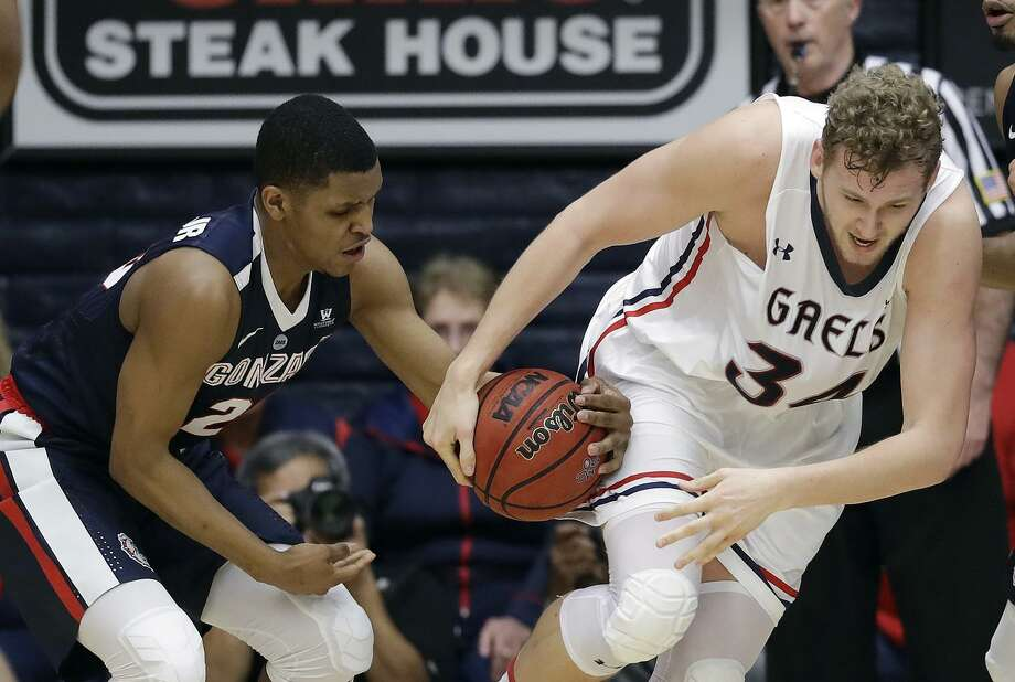 Gonzaga's Zach Norvell Jr. (left) strips the ball from Saint Mary's center Jock Landale during the first half Saturday. Landale, who attempted just one shot in the first half, had four points. Photo: Marcio Jose Sanchez / Associated Press / Copyright 2018 The Associated Press. All rights reserved.