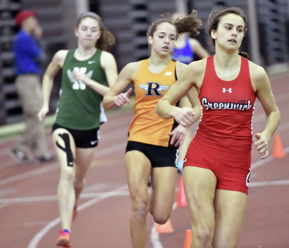 Greenwich's Genevieve DeWinter runs to a first place finish in the 600 at the Class LL championship on Saturday. Photo: Peter Hvizdak / Hearst Connecticut Media / New Haven Register