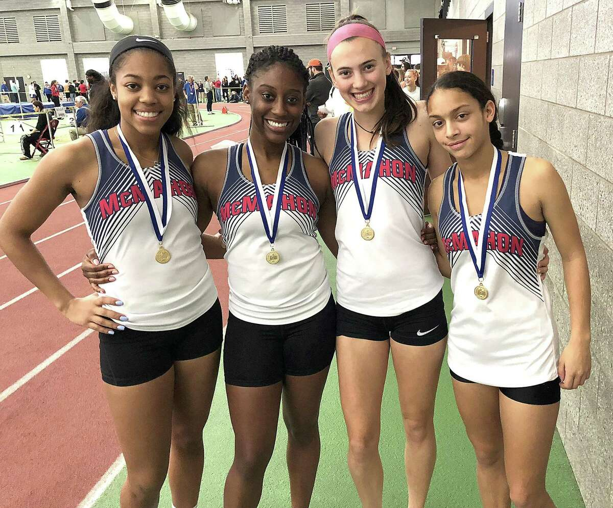 Brien McMahon?'s?' state Class LL championship 4x200 relay team of, from left, Savannah Bromley, Jazmijn Bien-Aime, Chloe Ortolano, and Peyton McNamara, pose for a photo with their medals at the Floyd Little Athletic Complex at Hillhouse High School in New Haven on Satuday. The Senators finished fifth as a team.