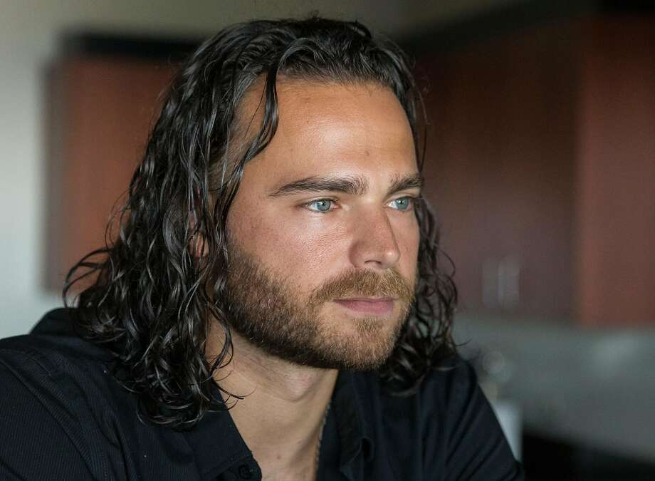 San Francisco Giants infielder Brandon Crawford speaks to reporters during media availability ahead of the San Francisco Giants FanFest at AT&T Park Friday, Feb. 9, 2018  in San Francisco, Calif. Photo: Jessica Christian, The Chronicle