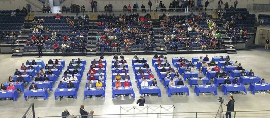 Houston ISD held its annual National Signing Day celebration Feb. 7 at Delmar Field House. More than 100 student-athletes from 16 schools signed scholarships in 10 sports with NCAA, NJCAA and NAIA institutions.