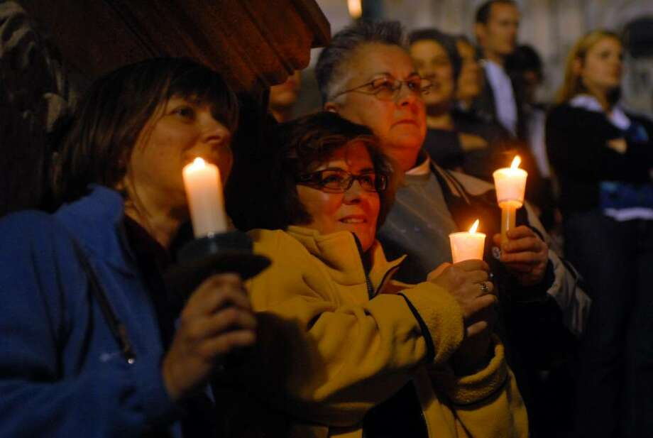 A rally and candlelight vigil for marriage equality were held outside of the Capitol in Albany, NY on Monday evening November 9, 2009. The State Senate is expected to take up the gay marriage issue this week, at the urging of Governor Paterson.( Philip Kamrass / Times Union) Photo: PHILIP KAMRASS / 00006335A