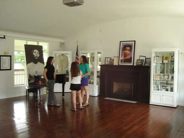 Interior of Marian Anderson studio, Danbury, Conn.  At left, with young visitors, is Anderson historian and Executive Director of the Danbury Museum and Historical Museum Brigid Guertin. (Michael Schuman)