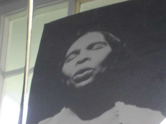 Portrait of Marian Anderson reflected in piano in her studio  -- piano similar to one used by her accompanist Franz Rupp, Danbury, Conn. (Michael Schuman)